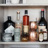 Vintage marble coaster, copper mugs and train liquor bottle provided by Garden Style and design by LeanneFordInteriors.com as seen on Domino.com